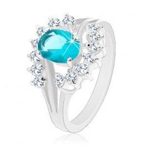 Lesklý prsten s rozvětvenými rameny, světle modrý zirkonový ovál, čiré oblouky G03.07