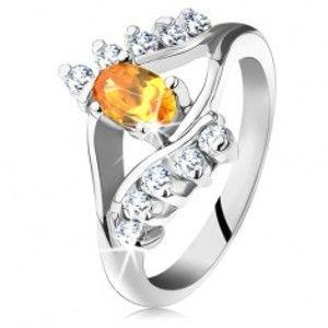 Prsten ve stříbrné barvě s úzkými rameny, žlutý oválný zirkon, čirá linie G10.24